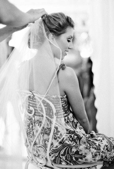 braided chignon hairstyle for brides wearing veils
