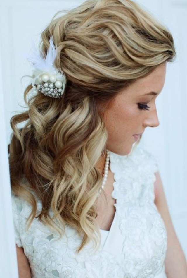 simple half up hairstyle with a beautiful pearl hair accessory is ...