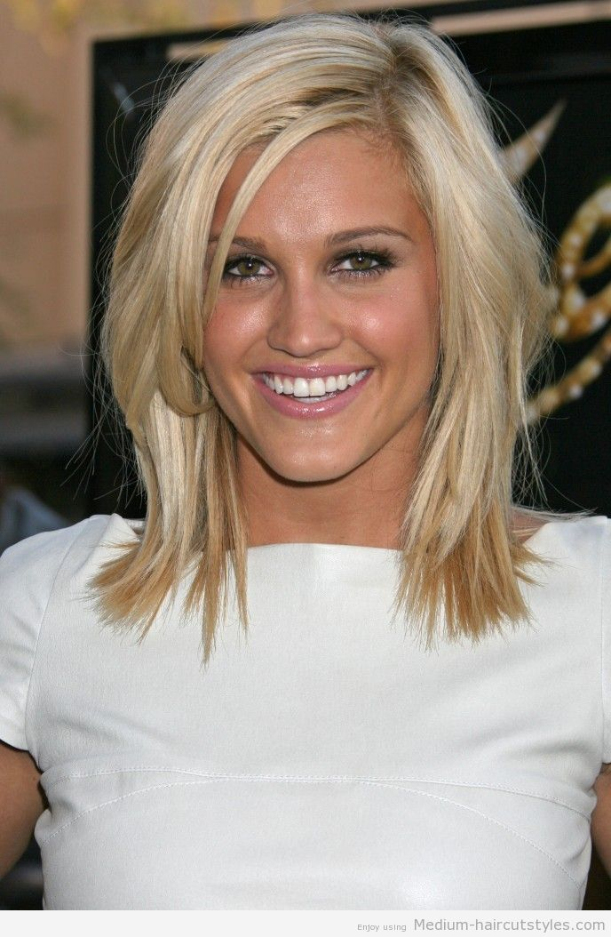 medium length hairstyle side part choppy layers for