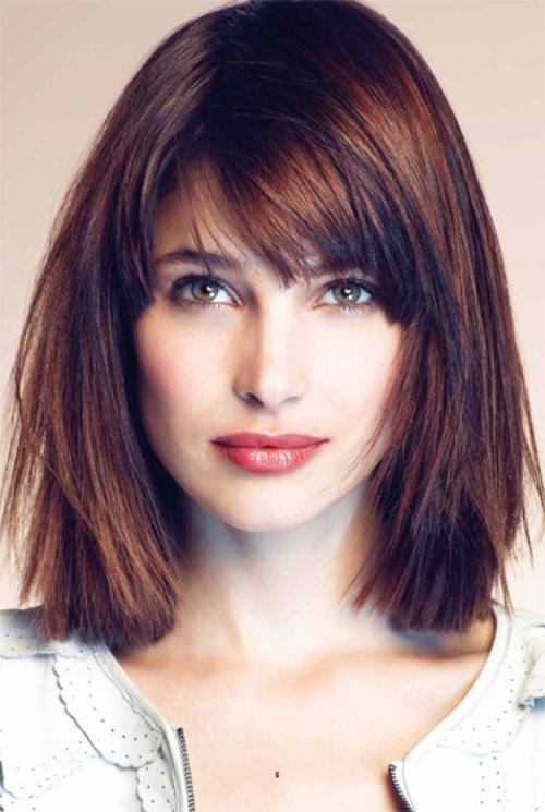 Edgy and subtly side-swept bangs are flattering on a square face.