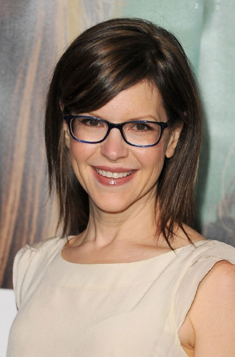 Best Hairstyle For Round Face And Small Forehead : Side swept bangs with glasses women hairstyles