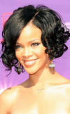 curly-bob-hairstyle-with-side-swept-bangs