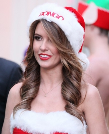 curly-hair-style-with-santa-hat-for-christmas-party